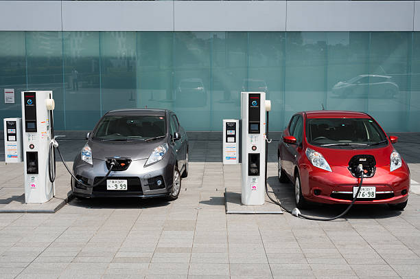 Electric cars being charged at charging stations Yokohama, Japan - July 19, 2016: Electric cars, Nissan's