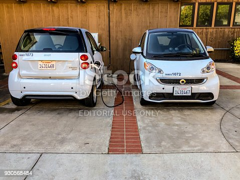 La Jolla, USA - January 04, 2018: Electric cars charging on a parking in La Jolla