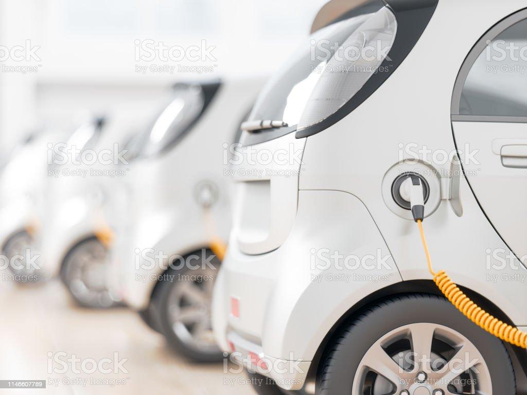 Electric cars charging Electric cars charging Agricultural Field Stock Photo