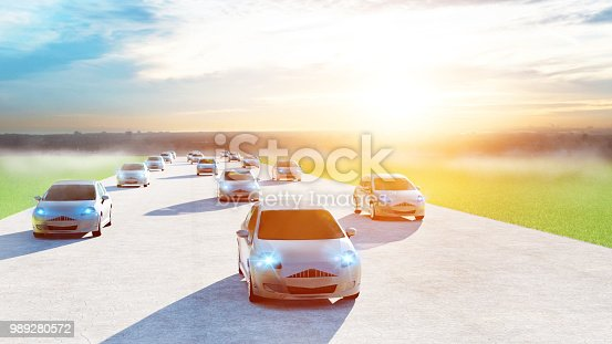 istock Electric cars drive fast on big road with smart city in the background 989280572