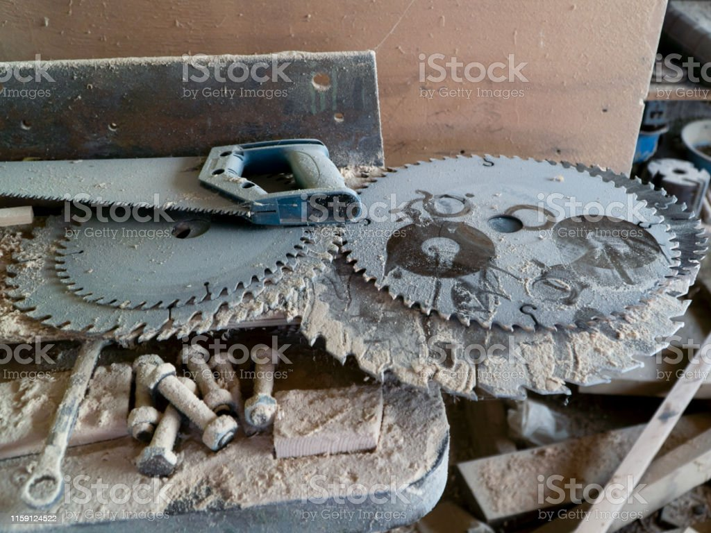 Surprising Electric Circular Saw Blades And Hand Saw On Carpentry Table Ocoug Best Dining Table And Chair Ideas Images Ocougorg