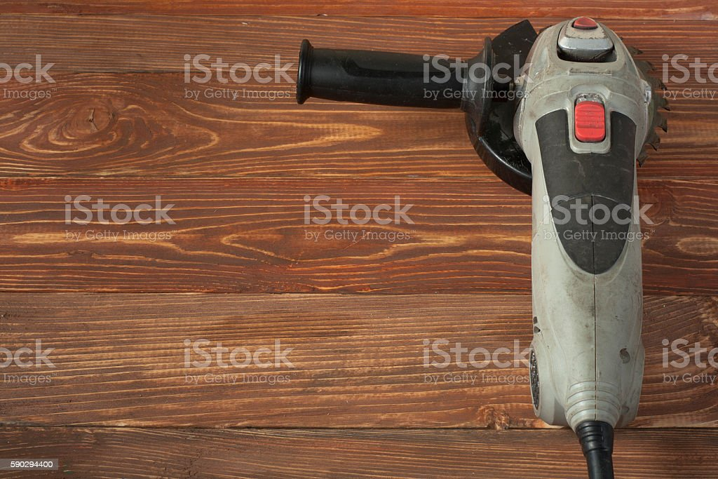 Electric circular saw on wood background. Copy space for text royaltyfri bildbanksbilder