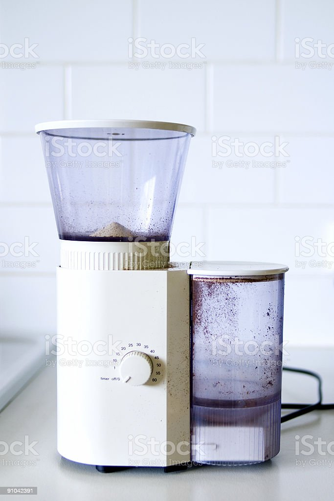 Electric coffee grinder in white domestic kitchen royalty-free stock photo
