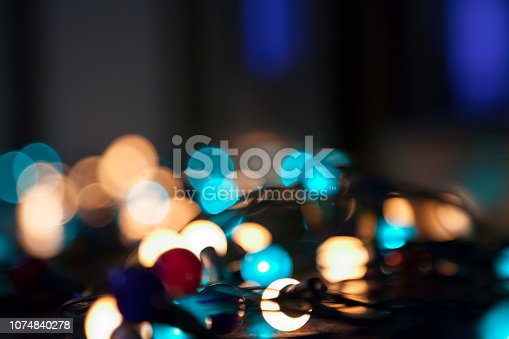 Colorful christmas lights. Shiny leds on black background