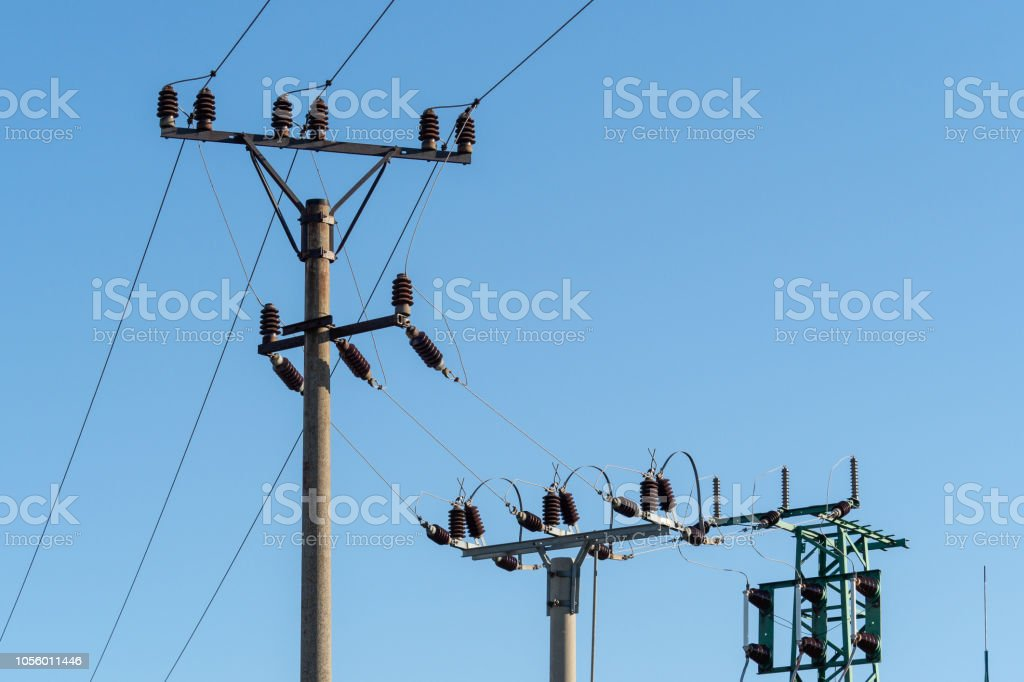 Electric Column And Wires Of High Voltage On Blue Sky ... on