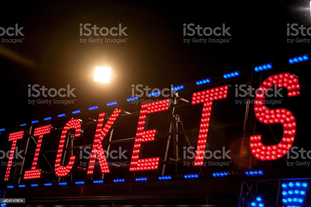 electric .COM sign on a scaffolding in the night stock photo