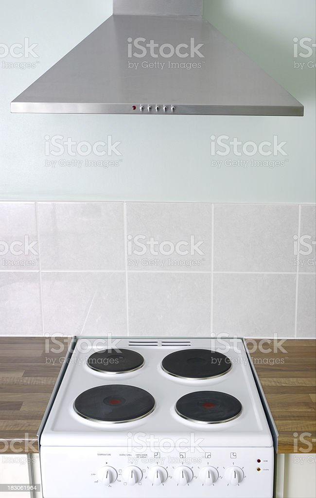 Electric Cooker And Hood in Small Modern Kitchen stock photo