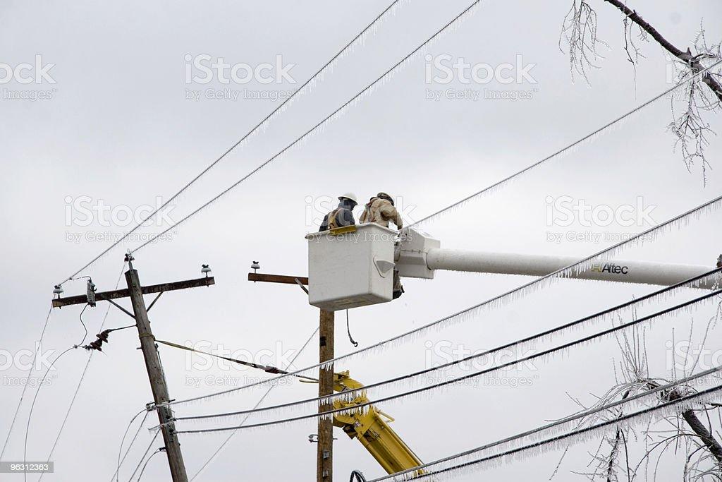 Electric Crews Work to Restore Power stock photo
