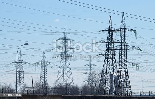 Electric current transmission line.Designed for power transmission.It takes place in the under construction area of the city.