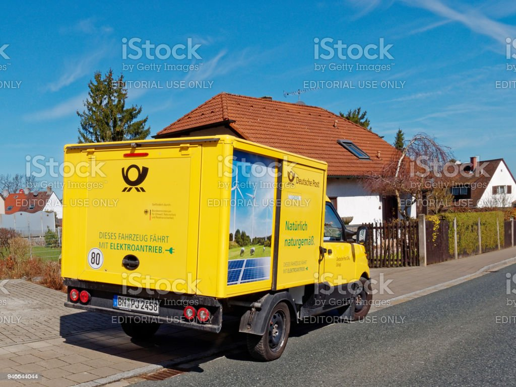 Electric Deutsche Post vehicle stock photo