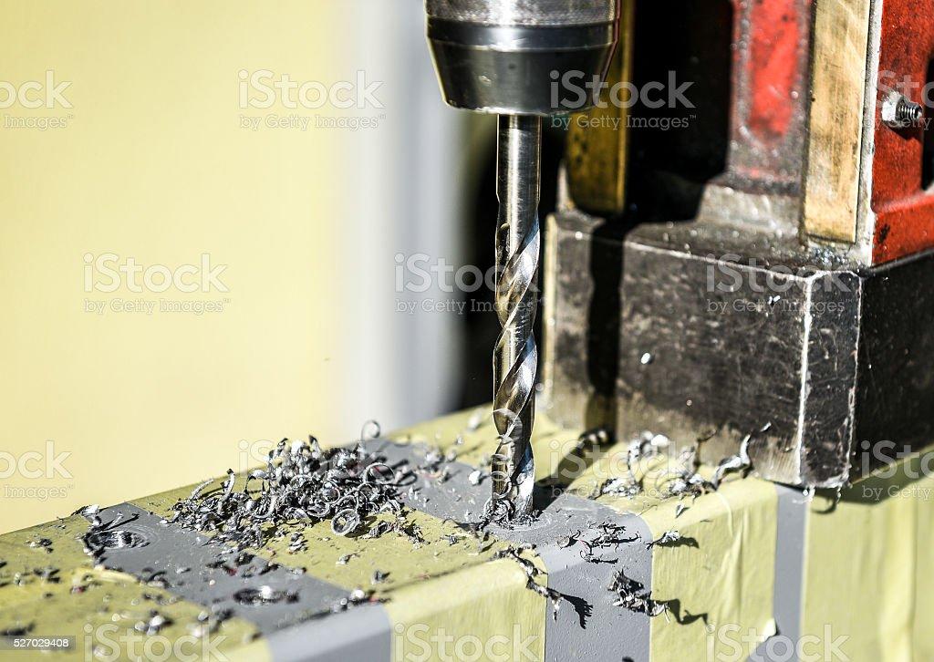 Electric drilling machine closeup in metal workshop stock photo
