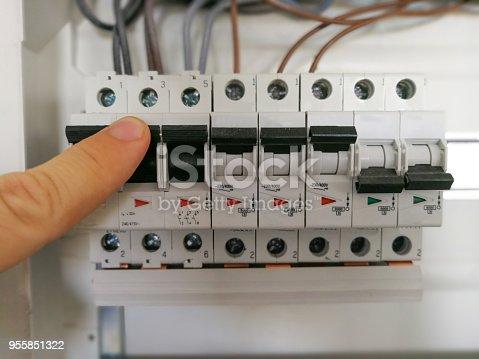 istock Electric engineer analyzes AC installation inside switch board cabinet 955851322