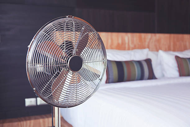 electric fan in the room stock photo