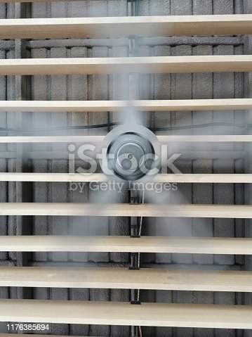 istock Electric fan rotating spinning on the wood wall 1176385694