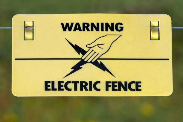 Electric Fence Warning Sign stock photo