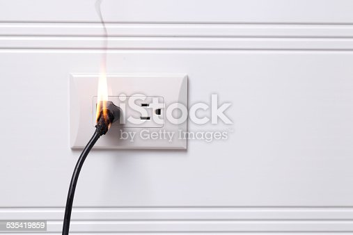 Electric plug on fire
