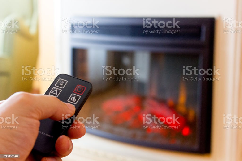 Electric fireplace remote control stock photo