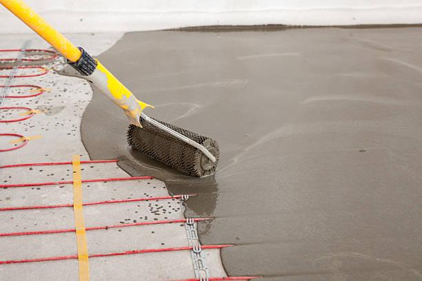 electric floor heating system installation in new house. - kabelkanal weiß stock-fotos und bilder