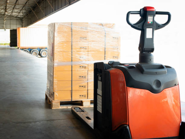 Electric forklift pallet jack with goods pallet for load into a truck Electric forklift pallet jack with goods pallet for load into a truck pallet jack stock pictures, royalty-free photos & images
