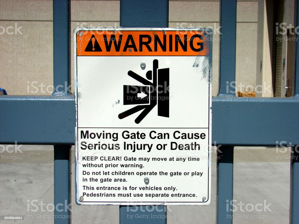 electric gate warning stock photo