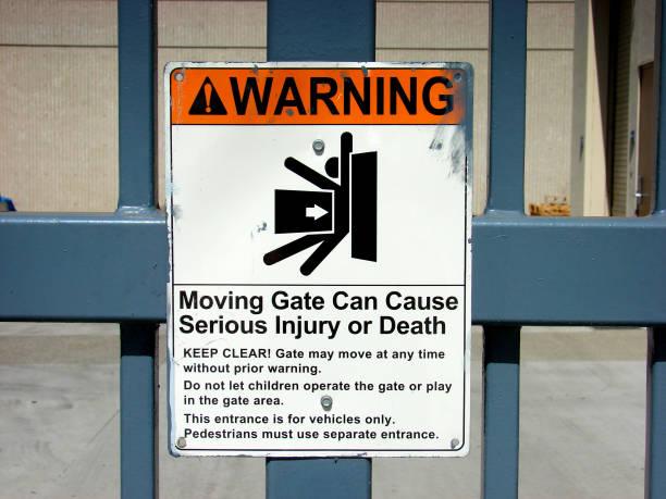electric gate warning stock photo