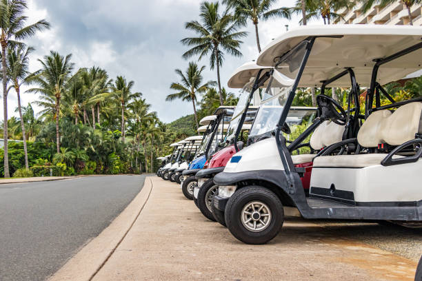 Electric golf - passenger buggies cars parked in row in Hamilton Island. stock photo