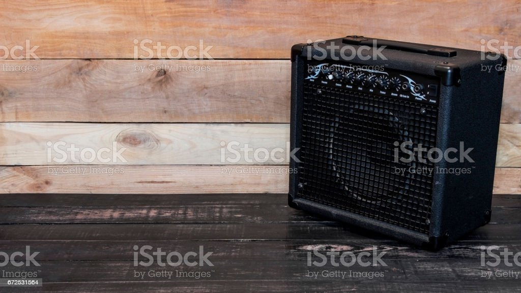 Electric guitar amplifier on wooden background stock photo