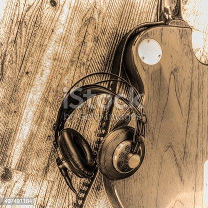 istock electric guitar and headphones in sepia tone 497491164