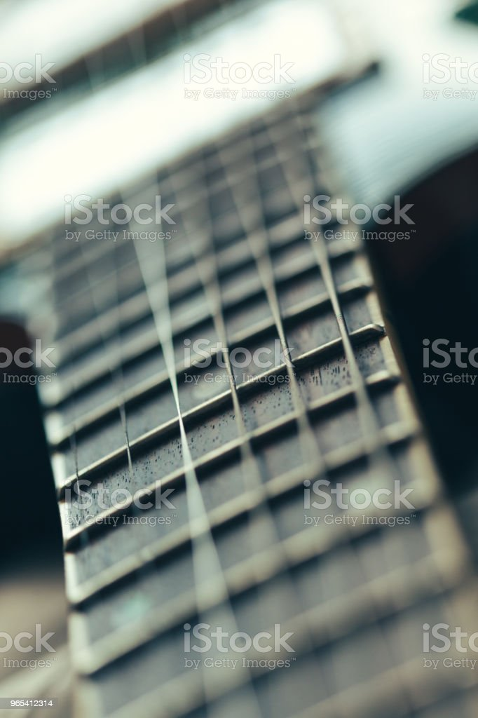 Electric guitar body and neck detail on wooden background royalty-free stock photo