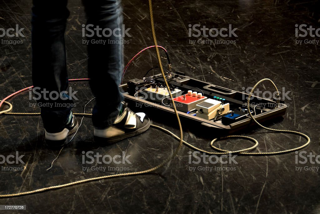Electric Guitar Effects Pedals on Stage royalty-free stock photo