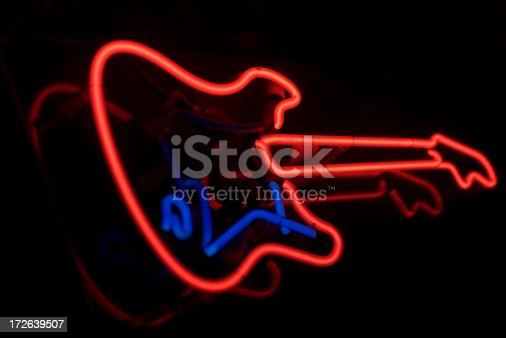 Electric guitar in bright red and blue neon