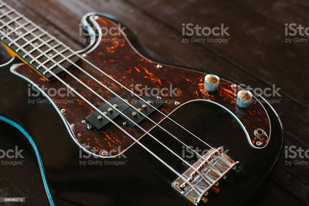 Electric guitar on a wooden surface. Conceptual background. royalty-free stock photo