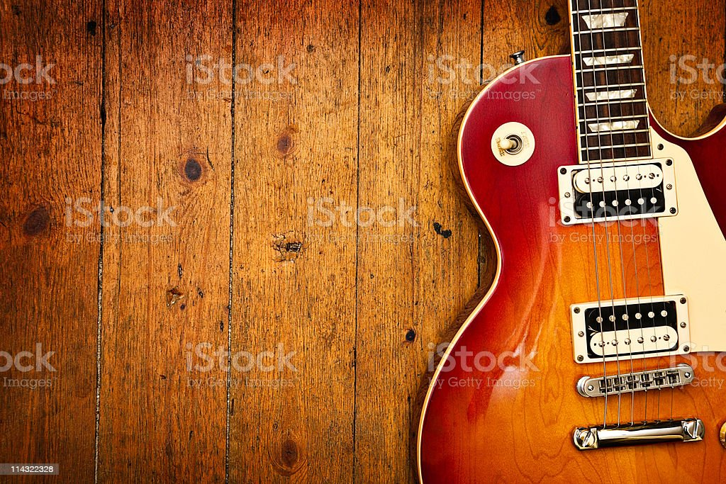 Electric guitar on wood royalty-free stock photo