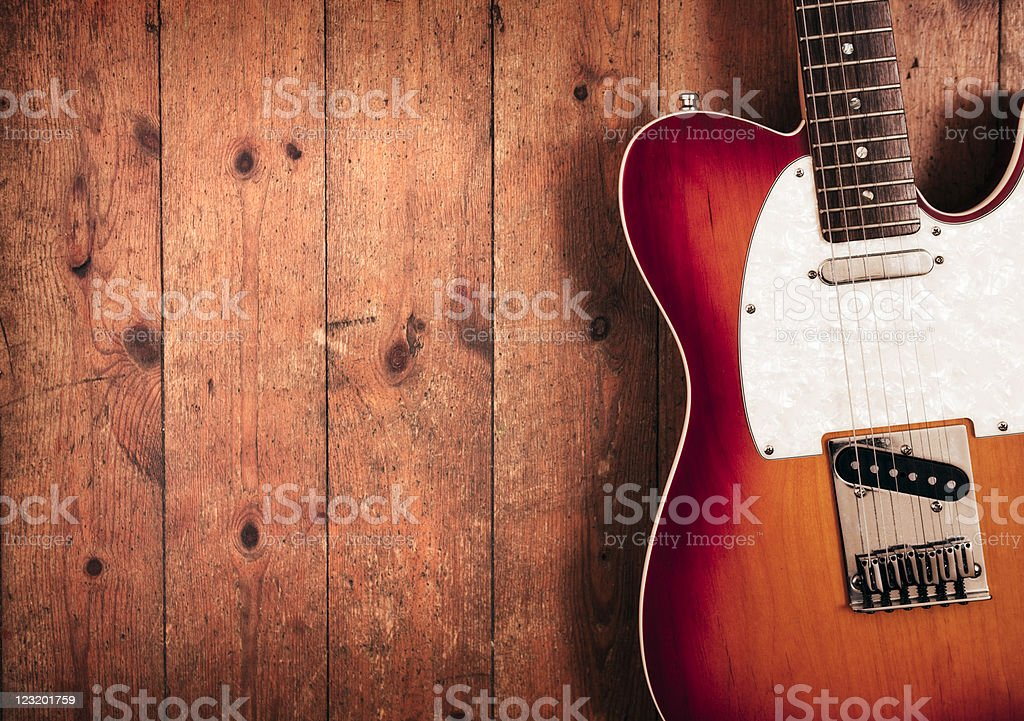 Electric guitar on wood stock photo