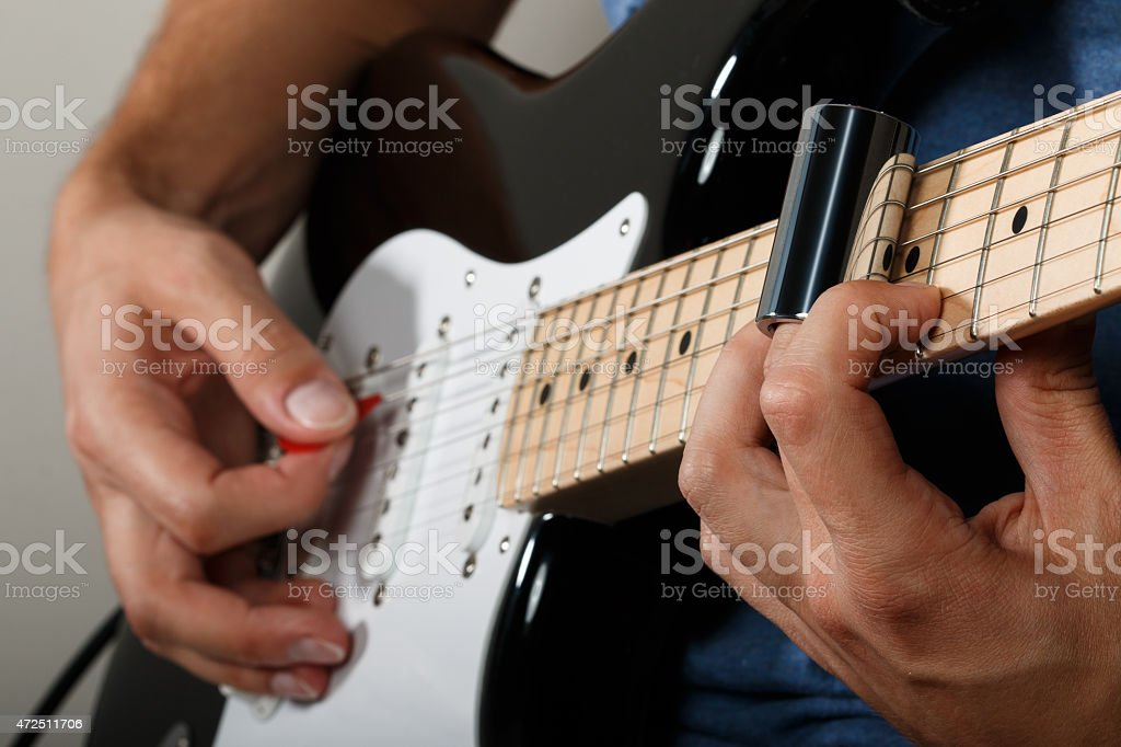 Electric guitar player performing song stock photo