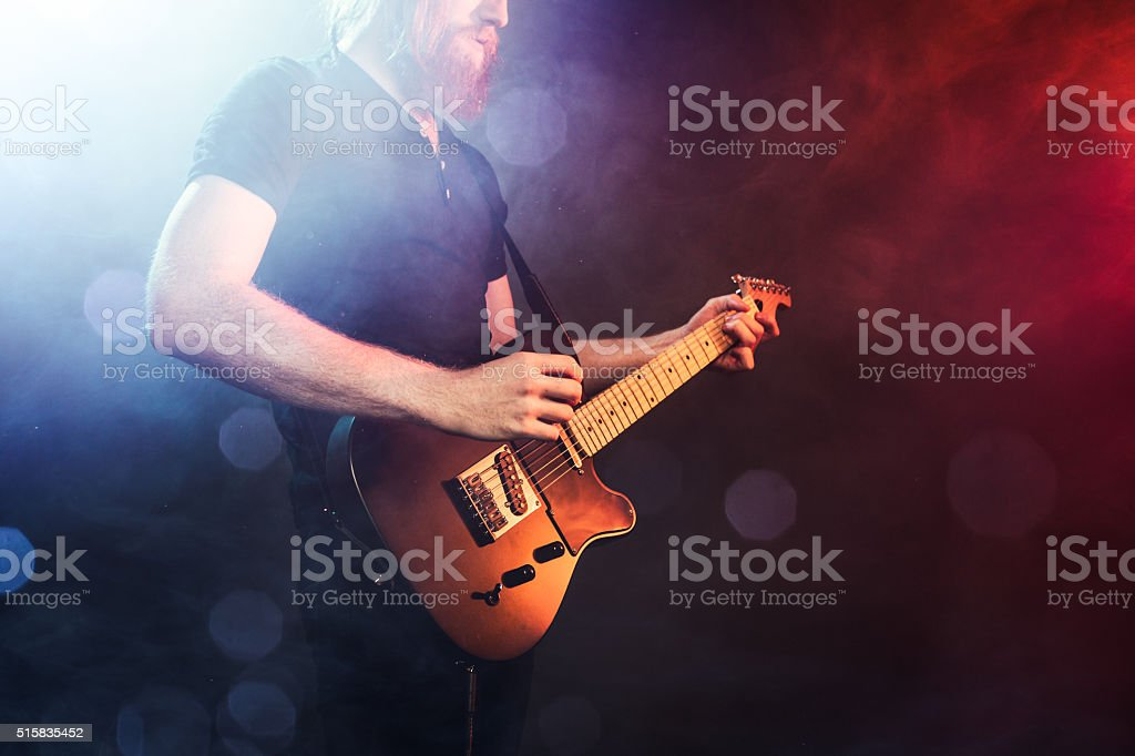 Electric Guitarist Playing Concert stock photo