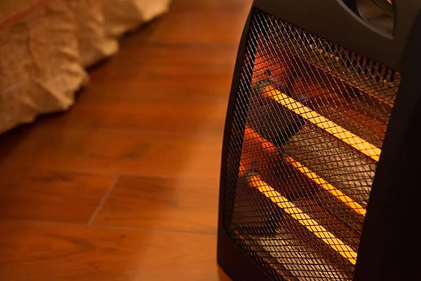 elektrischer ofen im bett zimmer - heizraum stock-fotos und bilder