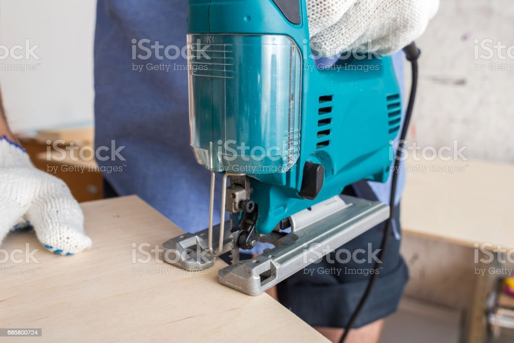 Electric Jig saw Close Up, Cutting Woodboard stock photo