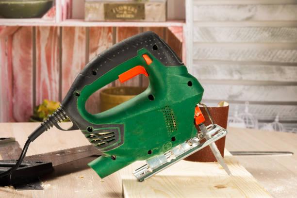 Electric jigsaw and various carpenter tools. stock photo