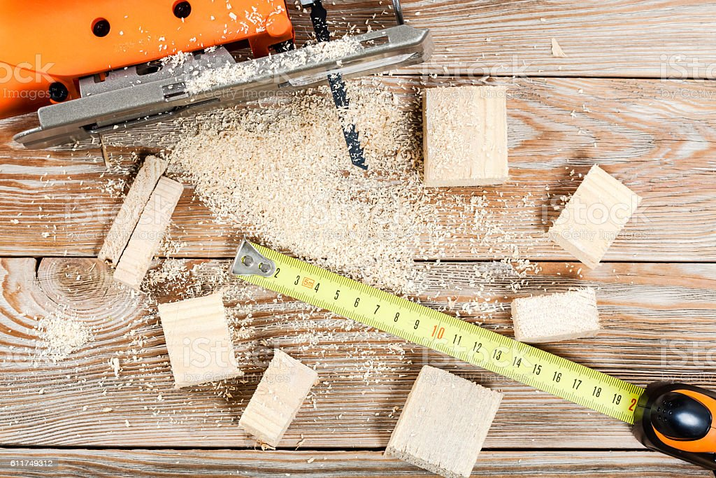 Electric jigsaw with many wooden bricks stock photo
