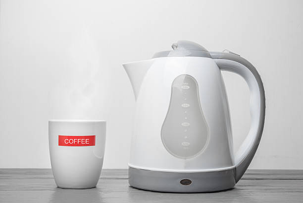electric kettle and coffee cup on wooden table - 電気部品 ストックフォトと画像
