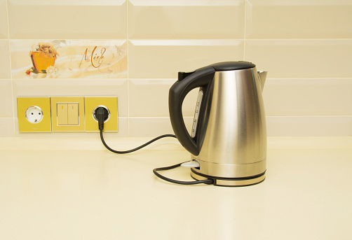 istock Electric kettle on the table in the kitchen 1049335742