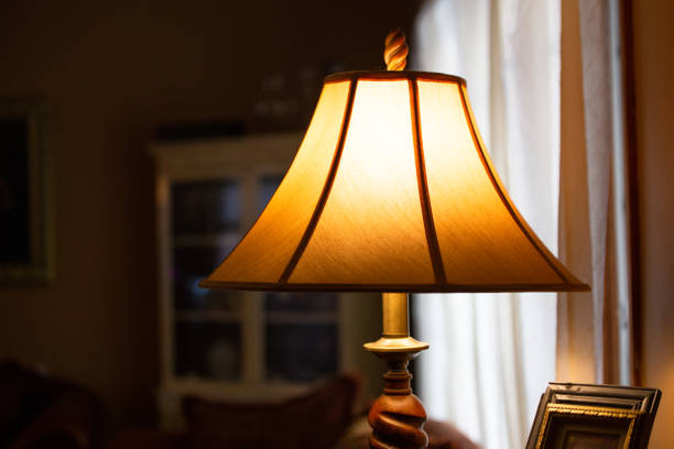 electric lamp in home - dimly stock pictures, royalty-free photos & images