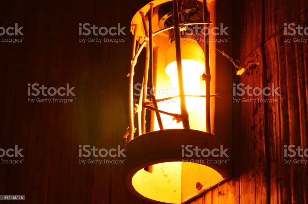 electric lamp retro style hanging on wall in the night
