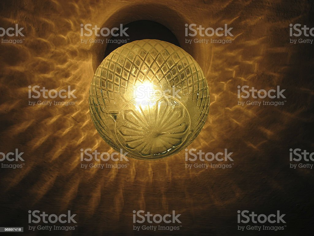 Electric lamp shines  dark premise. royalty-free stock photo