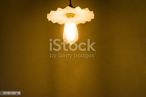 940992564 istock photo electric lamp with brown rock surface background. 1019126716