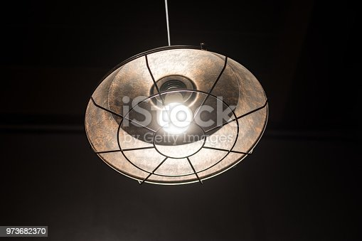 940992564 istock photo electric lamp with brown rock surface background. 973682370