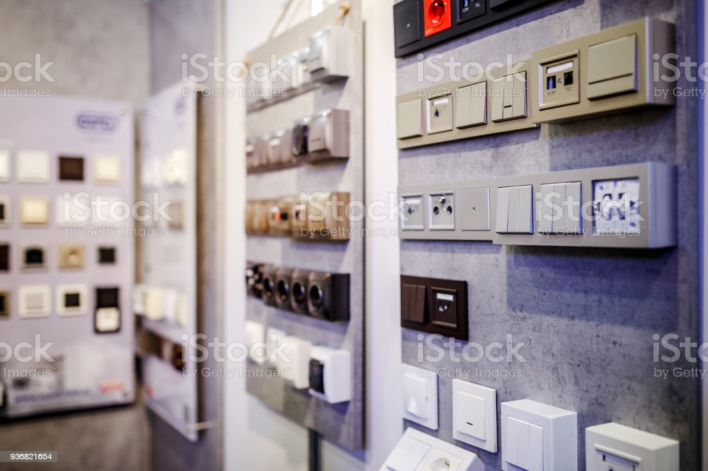 Electric light switch and socket on the empty wall stock photo