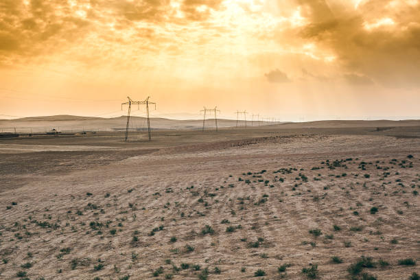 Electric line supports in the steppe stock photo