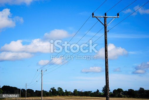 istock Electric lines at blue sky 522483541